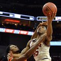 Louisville's Donovan Mitchell (45) is fouled by Syracuse's Taurean Thompson (12) during the second half of an NCAA college basketball game, Sunday, Feb. 26, 2017, in Louisville, Ky.