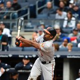 Orioles' Michael Bourn breaks finger catching football