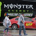 FILE - In this Feb. 23, 2017, file photo, fans walks through the garage area after rain postponed practice for the Daytona 500 NASCAR Cup series auto race at Daytona International Speedway in Daytona Beach, Fla. Monster Energy is set to start a two-year sponsorship deal with a two-year option worth a reported $20 million annually _ a staggering discount from the $750 million, 10-year deal Sprint had paid NASCAR to have its name emblazoned in the title series. (AP Photo/Terry Renna, File)