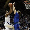 Villanova's Kris Jenkins, left, goes up for shot against Creighton's Toby Hegner during the first half of an NCAA college basketball game, Saturday, Feb. 25, 2017, in Villanova, Pa.