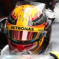 Mercedes driver Lewis Hamilton of Britain sits in his car in the team box during a Formula One pre-season testing session at the Catalunya racetrack in Montmelo, outside Barcelona, Spain, Tuesday, Feb. 28, 2017. (AP Photo/Francisco Seco)
