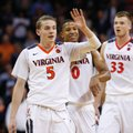 Virginia guard Kyle Guy (5) and guard Devon Hall (0) celebrate a shot during the second half of an NCAA college basketball game against North Carolina in Charlottesville, Va., Monday, Feb. 27, 2017. Virginia won 53-43.