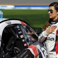 Danica Patrick stands by her car during the national anthem before the NASCAR Clash auto race at Daytona International Speedway, Sunday, Feb. 19, 2017, in Daytona Beach, Fla. (AP Photo/John Raoux)