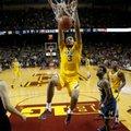 Minnesota's Jordan Murphy (3) dunks during an NCAA college basketball game against Michigan, Sunday, Feb. 19, 2017, Minneapolis.