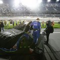 Jimmie Johnson's car is covered on pit road during a rain delay before the NASCAR Clash auto race at Daytona International Speedway, Saturday, Feb. 18, 2017, in Daytona Beach, Fla. (AP Photo/John Raoux)