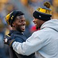 """This Jan. 1, 2017 photo shows Pittsburgh Steelers wide receiver Antonio Brown, left, and running back Le'Veon Bell celebrating on the sideline after a Steelers touchdown during the second half of an NFL football game against the Cleveland Browns in Pittsburgh. Steelers general manager Kevin Colbert stressed earlier this month one of the team's biggest goals during the offseason was to make wide receiver Antonio Brown and running back Le'Veon Bell vital parts of the organization """"for life."""" (AP Photo/Jared Wickerham)"""