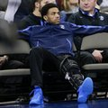 Creighton's Maurice Watson Jr., out for the season due to a torn ACL, sits on the bench during the second half of an NCAA college basketball game against Marquette in Omaha, Neb., Saturday, Jan. 21, 2017. Marquette won 102-94.