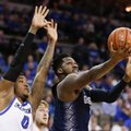 Georgetown's L.J. Peak, right, goes for a layup against Creighton's Marcus Foster (0) during the first half of an NCAA college basketball game in Omaha, Neb., Sunday, Feb. 19, 2017.