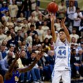 North Carolina's Justin Jackson (44) shoots for three over Pittsburgh's Jamel Artis (1) during the second half of an NCAA college basketball game, Saturday, Feb. 25, 2017, in Pittsburgh. North Carolina won 85-67.