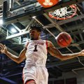 Cincinnati's Jacob Evans dunks during the first half of the team's NCAA college basketball game against Memphis, Thursday, Feb. 23, 2017, in Cincinnati. Cincinnati won 87-74.