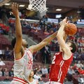 Wisconsin's Ethan Happ, right, tries to shoot over Ohio State's Trevor Thompson during the first half of an NCAA college basketball game Thursday, Feb. 23, 2017, in Columbus, Ohio.