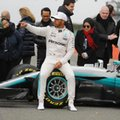 Mercedes driver Lewis Hamilton of Britain poses for photographers at the launch of the new Mercedes F1 car at the Silverstone racetrack in Towcester, England, Thursday, Feb. 23, 2017. (AP Photo/Frank Augstein)