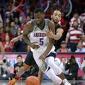 Arizona guard Kadeem Allen (5) shields the ball from Southern California guard Jordan McLaughlin during the second half of an NCAA college basketball game, Thursday, Feb. 23, 2017, in Tucson, Ariz. Arizona defeated Southern California 90-77.