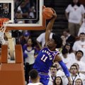 Kansas guard Josh Jackson (11) sails to the basket over Texas guard Eric Davis Jr. (10) during the second half of an NCAA college basketball game, Saturday, Feb. 25, 2017, in Austin, Texas. Kansas won 77-67.