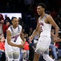 Arizona's Parker Jackson-Cartwright (0) and Allonzo Trier celebrate after Arizona defeated Southern California 90-77 during an NCAA college basketball game, Thursday, Feb. 23, 2017, in Tucson, Ariz.
