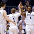 Butler forward Tyler Wideman (4) celebrates a basket with guard Tyler Lewis (1) and forward Andrew Chrabascz (45) in the second half of an NCAA college basketball game against DePaul in Indianapolis, Sunday, Feb. 19, 2017.