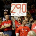 A Gonzaga fan holds a 29-0 sign during the second half of Gonzaga's NCAA college basketball game against San Diego on Thursday, Feb. 23, 2017, in San Diego. Gonzaga won 96-38.