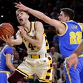 Arizona State guard Torian Graham (4) shoots under UCLA forward TJ Leaf (22) during the second half of an NCAA college basketball game, Thursday, Feb. 23, 2017, in Tempe, Ariz.
