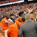 Syracuse players and fans celebrate after beating Duke in the finals seconds of an NCAA college basketball game in Syracuse, N.Y., Wednesday, Feb. 22, 2017. Syracuse won 78-75.
