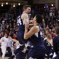 BYU forward Davin Guinn, left, and center Corbin Kaufusi celebrate after BYU defeated No. 1 Gonzaga 79-71 in an NCAA college basketball game in Spokane, Wash., Saturday, Feb. 25, 2017.