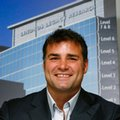 FILE - In this Sept. 16, 2008, file photo, Eric Lindros smiles at a press conference after he was recognized for his $5 million donation to London Health Sciences with the unveiling of the Lindros name atop the building at University Hospital in London, Ontario. At a time when Eric Lindros is auctioning off a small portion of his memorabilia, the former NHL star power forward acquired a curious piece to his collection: A Quebec Nordiques jersey. Some 26 years after refusing to play for the Nordiques, Lindros chuckles over being presented the jersey during an appearance on a French-Canadian TV show last weekend. (AP Photo/The Canadian Press, Dave Chidley, File)