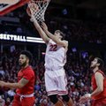 Wisconsin's Ethan Happ (22) shoots between Maryland's Jaylen Brantley, left, and Michal Cekovsky during the second half of an NCAA college basketball game Sunday, Feb. 19, 2017, in Madison, Wis.