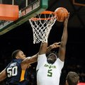 West Virginia's Sagaba Konate (50) and Maciej Bender (25) defend as Baylor's Johnathan Motley (5) goes up to dunk the ball in the second half of an NCAA college basketball game, Monday, Feb. 27, 2017, in Waco, Texas.