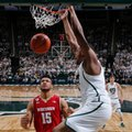 Michigan State's Nick Ward, right, dunks over Wisconsin's Charles Thomas (15) during the first half of an NCAA college basketball game, Sunday, Feb. 26, 2017, in East Lansing, Mich.