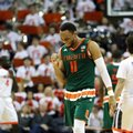 Miami guard Bruce Brown (11) celebrates during overtime of an NCAA college basketball game against Virginia, Monday, Feb. 20, 2017, in Charlottesville, Va. Miami defeated Virginia 54-48.