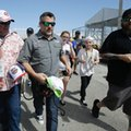 Car owner Tony Stewart, center, is surrounded by fans seeking autographs as he walks through the garages at a NASCAR auto racing practice session at Daytona International Speedway, Friday, Feb. 24, 2017, in Daytona Beach, Fla. (AP Photo/John Raoux)