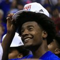 Kansas guard Josh Jackson dons his Big 12 championship hat following the team's NCAA college basketball game against TCU in Lawrence, Kan., Wednesday, Feb. 22, 2017. Kansas defeated TCU 87-68. The Jayhawks clinched at least a tie for their 13th straight Big 12 title.