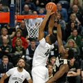 Penn State's Julian Moore (44) goes up for the dunk as Purdue's Caleb Swanigan (50) defends during the first half of an NCAA college basketball game in State College, Pa., Tuesday, Feb. 21, 2017.