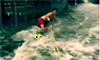 Man Waterskis Through City Flood